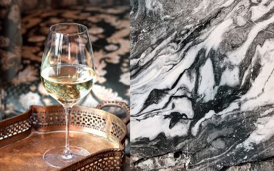 Glass of white wine next to image of black and white marble